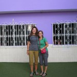 Elizabeth and Mariah pose in front of the Casa Luz orphanage, freshly painted purple!