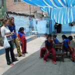 The children play an educational game of musical chairs.