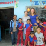 Mariah and Elizabeth pose with their class and the regular teacher for the class.