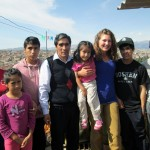 Elizabeth poses with her host family on their porch overlooking Ayacucho.