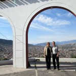 Karen and Duane pose under the arches at the mirador, overlooking Ayacucho.