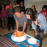 Max and Maddie blowing out candles.