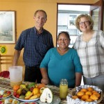 Duane and Karen pose with Alicia before her fruit presentation.