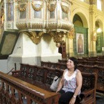 Celia sitting on a bench in Lima's main cathedral.