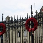 Wreaths displayed along the gate in front of the palace are decorated with fabric representing the different provinces in Peru.