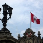 The Peruvian flag flies over the Government Palace, where Peru's president lives.