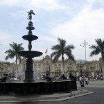 A view of the Government Palace behind the fountain in Lima's central plaza.