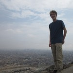 Christian stands on the wall that overlooks the city of Lima.