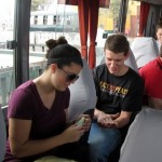 Maria and Micah share hand sanitizer on the bus before heading back to El Buen Pastor.