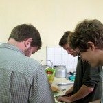 Ammon, Christian and Micah at work in the kitchen.