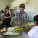 Christian works with Alicia to prepare causa rellena.