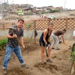 Micah, Jo, Ike and Ammon take their turn at working the sandy soil in a Villa Maria community garden.
