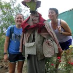 Lea and Maria pose in front of the female scarecrow (espantapájaras).