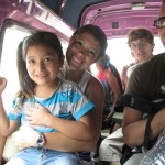 Maria with her new friend (Alicia's granddaughter, Saray) in a combi.