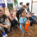 Alicia's granddaughter, Saray, shares Fanta Orange with the students.
