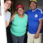 Karen with Alicia and Oswaldo in front of the house they've been working on.
