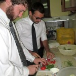 Ammon and Ike chop tomatoes for the guacamole.
