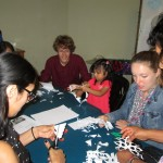 Christian and Courtney make snowflakes with family members.