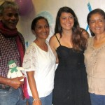 Maria poses with her host parents and aunt.