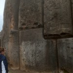 Courtney stands by the big carved boulder at Saqsayhuama, which weighs about 70 tons.