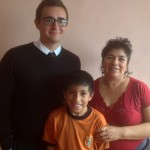 Ike with his host mother, Nieves Bautista Gomez, and her son, Javier, 10.