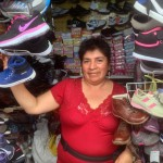 Nieves showed us the market stand where she sells shoes seven days a week.