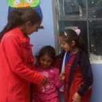 Carmen, the lead teacher, and several students from the school.