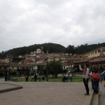 Maria takes a photo in Cusco's famous Plaza de Armas.