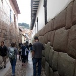 Walking toward the 12-angled stone with our guide in Cusco.