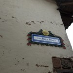 One of many ornate street signs in central Cusco.