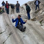 Amadeo shows us the proper sliding technique at the sliding rocks.