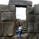 Elizabeth poses in a doorway at Saqsayhuaman.