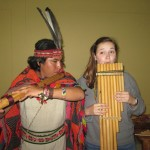 Elizabeth tries out a pan flute with one of musicians who performed for us during a workshop in Cusco.