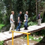 The men head across the bridge to the trout farm for lunch.