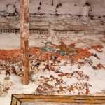 A close up of the paintings on the outside of the church.