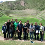 We pose for a group photo after climbing into the basin of terraces at Moray.