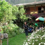 Maria takes a turn at sapo at our hostal in Ollantaytambo.