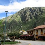 The town square in Ollantaytambo is simple but welcoming, surrounded by mountains - and many pleasant cafes.