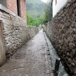 Gutters channel water through most of the cobblestone streets in Ollantaytambo.