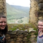 Lea and Courtney pose overlooking Ollantaytambo.