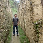 Micah stands in the middle of a narrow Ollantaytambo street.
