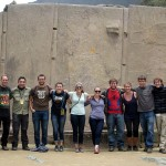 A group photo in front of the granite Wall of the Six Monoliths at the Temple of the Sun, thanks to Elizabeth's tripod.