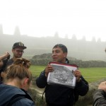 Our guide, Amadeo, shows a picture of a helicopter that landed at Machu Picchu during an advertising shoot that caused damage to the site.