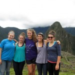 The GC women pose for a photo at Machu Picchu.