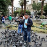Willy feeding pigeons in the main plaza in Arequipa.