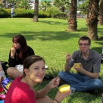 Morgan and Peter dig into their picnic lunch of causa rellena con pollo.