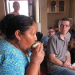 Alicia demonstrates one of several ways to eat granadilla.