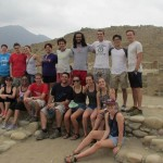 A group photo in front of Caral's main pyramid.
