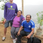 Alicia and Oswaldo pose with adopted grandson, David, at their new home-with-a-view.