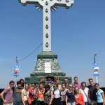Just before leaving, we pause for a mandatory group photo at the foot of the cross.